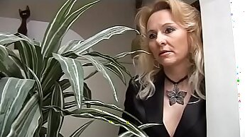 Boschy mom and stud jerking cock in office