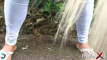 Big tit blonde tugging and peeing in public