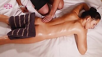 couple of babes are giving a hot hottie an erotic massage