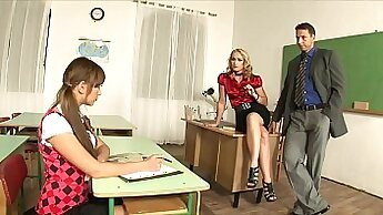 Busty teacher in threesome in the classroom